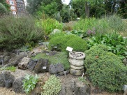 pond rockery with masonry from Tower of London